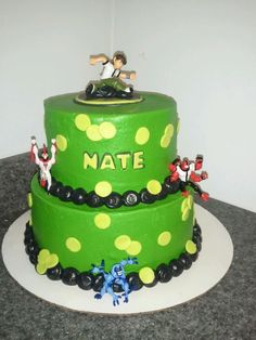 ben 10 - Customer sent me a picture similar to this cake and asked me to recreate it.  Not sure who the original was by.  Buttercream with fondant dots