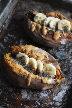 Breakfast baked sweet potatoes stuffed with creamy almond butter, banana slices, chia seeds a sprinkle of cinnamon! An easy to make paleo breakfast that tastes like dessert!