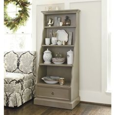 Very nice idea for a bookcase/china cabinet. and I love the color. This is from Ballard Designs.
