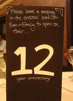 Guest Book Idea - Each book is a Table Number, so each guest table writes in a different book. I love this idea!