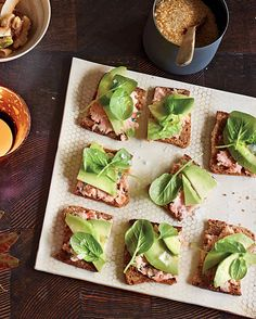 The menu at your afternoon get-together need not be fussy. Whole-grain crackers stand in for traditional tea sandwiches., and salmon salad is a healthy topping.