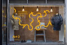 Visual identity and widow decals designed by Bedow for Swedish clothing and gadget retailer Adisgladis