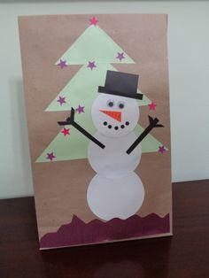 Embrulho de natal.Utilizando papel craft. Motivo: Snow Man feito com papel.