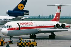 Interflug Ilyushin IL-62M parked near a Lufthansa McDonnell-Douglas DC-10-30; shows the contrast between East and West German commercial aviation