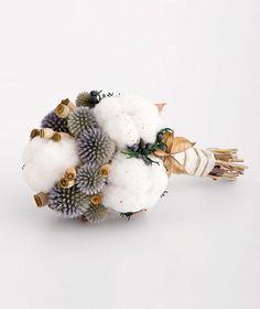Complement a cozy outdoor affair with a rustic cotton bouquet filled with dried cotton burrs, echinops, and poppy pods.