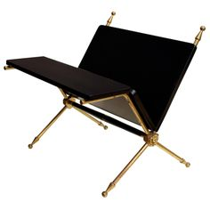 Classy brass and ebonized & French polished wood magazine stand with lion head detail by Maison Charles