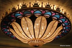 http://www.disneyfoodblog.com/2013/04/05/guest-review-royal-court-aboard-the-disney-fantasy-cruise-ship/ Fantasy Chandelier