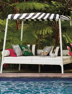 Your own private oasis - imbued with sophisticated coastal style - awaits. The spectacular Reef Daybed brings seaside luxury to your outdoor space with a classic cabana aesthetic.    Frontgate: Live Beautifully Outdoors