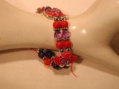 Double Strand Beaded Red Hat Charm Bracelet.  Has a double strand of red, purple and silver beads, with intermingled multiple Red Hats on a stretch Bracelet.  Great Gift idea for your favorite Red Hat Lady!  Only $8.95 myredhatstore.com