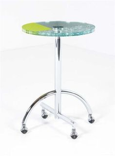 """SHIRO KURAMATA """"Sally"""" table, 1987  Glass, chrome-plated steel. 30 1/4 in. (76.8 cm) high, 20 7/8 in. (53 cm) diameter. Manufactured by Memphis, Italy/Japan."""