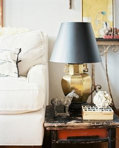 end table, gold lamp, mixed materials + textures.