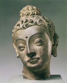 This beautiful head of the Buddha was once part of a large-scale narrative panel modelled in high relief. It formed part of a life-size figure, probably of Gautama the Buddha as a young man. Like much Gandharan stucco, this head was originally richly polychromed, and traces of red remain on the lips, eyelids and hair. 4th century-5th century (made)