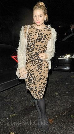 Seen on Celebrity Style Guide: Sienna Miller wore this pale caramel with black animal-print dress to Kelly Hoppen's book launch November 18....http://bit.ly/1aPG190
