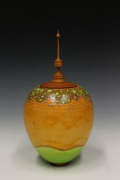 I just want to remember to try a LID like that. LOL Alternative Raku Sagger Pottery with Wood Turned Lid by palm2188