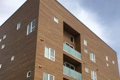 Beautiful Summer Wheat RusticSeries Siding on Allura Fiber Cement. Multifamily Commercial Architectural Design. Faux Wood look siding