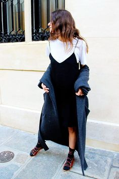 The Layer Game: White Top, Black Slip Dress, and Coat. Similar Style Available at SiiZU