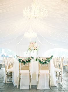 Love this bride and groom seating decor