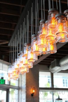 These mason jar lights would be so easy to make and really cool for an outdoor bar area :: from-Table for Two