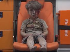 Omran Daqneesh after his home was bombed by government forces in Aleppo Syria