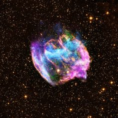 This highly distorted supernova remnant may contain the most recent black hole formed in the Milky Way galaxy. The composite image combines x-rays from Chandra (blue and green), radio data from the Very Large Array (pink), and infrared data from the Palomar Observatory (yellow).