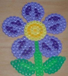 Violet flower hama beads by Merrily Me Fuse Bead Patterns, Perler Patterns, Beading Patterns, Flower Patterns, Mini Hama Beads, Pearler Beads, Fuse Beads, Melted Bead Suncatcher, Flora