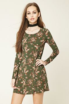 Style Deals - A stretch-knit dress featuring an allover floral print, flared silhouette, scoop neckline, and a back cutout with self-tie accent.