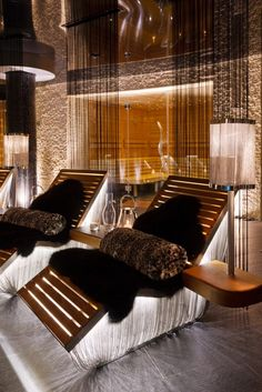 Bespoke lounger in the spa at Chalet Zermatt Peak made from teak and lit from underneath. Faux fur throws to finish and give added comfort Bespoke Furniture, Furniture Design, Swiss Chalet, Mountain Decor, Nature Beach, Master Shower, Saunas, Zermatt, Cabin Homes