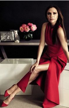 Who made Victoria Beckham's red pleated dress?