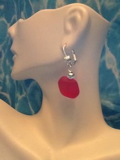 A personal favorite from my Etsy shop https://www.etsy.com/listing/240015477/cherry-red-beach-sea-glass-silver
