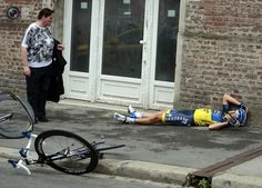 Team Saxo Bank rider Cantwell of Australia lies on the ground after a fall during the fifth stage of the 99th Tour de France cycling race between Rouen and Saint-Quentin. © POOL New / Reuters/REUTERS