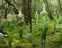 """art in Scotland's Forests --    Rob Mullholland's """"Vestige"""" mysterious human-shaped mirror sculptures reflect and refract timber and leaves.  The installation was so well received that Mullholland was commission to create six more mirrored sculptures, to be permanently installed within the forest's confines for hikers to discover on their walks through the terrain."""