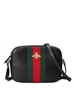 """Gucci black leather shoulder bag. Embroidered gold bee on our signature wool web. Hand-painted edges. Adjustable shoulder strap with 20"""" drop. Natural cotton linen lining. Open and smartphone pocket."""