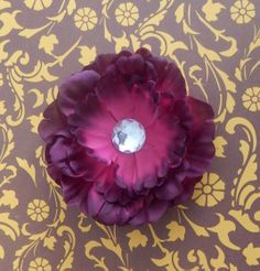 """Each small peony measures about 4"""" across, and has 5 layers of petals and is attahced to a single prong metal hair clip. The center stone can be changed to to any color you wish, just let me know in a message. Color may vary due to each computer showing color differently."""