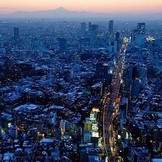 National Geographic Travel - Sunset over Tokyo with Mount Fuji in the background.