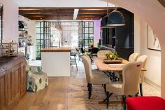 A spacious six-story townhouse designed for family living features bright and airy interiors, sited in the desirable New York location of Greenwich Village. Greenwich Village, Manhattan, Wrought Iron Staircase, Townhouse Designs, West Village, Decoration, Rooftop, Living Spaces, Home And Family