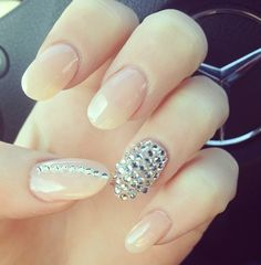 Stiletto Nails with some nude sparkle