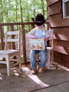 A cowboy having lunch in the playhouse.