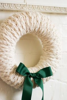 Free Knitting Pattern for Finger Knit Wreath - Anne Weil designed this easy stylish decoration that is made by wrapping a finger knit cord around a styrofoam wreath form.