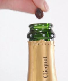 Use this simple raisin trick to revive a bottle of Champagne that's gone flat.