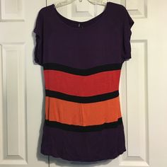 Maurices Color Block Top Maurices color block top. Mostly a dark purple with orange, reddish orange, and black. Can be dressed up or down. Very stretchy! - 95% rayon 5% spandex. Maurices Tops Tees - Short Sleeve