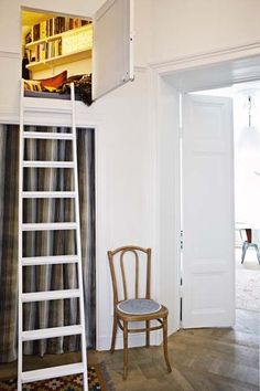 17 cozy book nook ideas, including this small reading nook that can only be accessed by ladder!