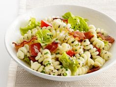 BLT Pasta Salad : Transform the classic sandwich into a picnic-perfect pasta salad: Crispy bacon, ripe summer tomatoes and fresh lettuce pop against the creamy pasta spirals.