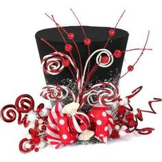 Sweeten your holiday this year with a Candy Christmas tree. This brightly colored whimsical top hat is perfect as a tree topper, table decoration, Grinch Christmas Tree Decorations, Christmas Party Hats, Diy Christmas Tree Topper, Candy Cane Christmas Tree, Christmas Tree Tops, Holiday Hats, Magical Christmas, Christmas Centerpieces, Christmas Tables