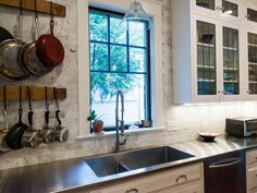 Stainless steel countertops aren't just for sleek modern spaces. Here, Dave Vogt of Case Design/Remodeling, Inc., used the metal in a country-style kitchen, where the gleaming surface contrasts beautifully with exposed brick and the well-worn bottoms of the homeowners' cookware. Over time, the counters may scratch and show wear – but that's part of their charm in a space like this – and they are super durable.