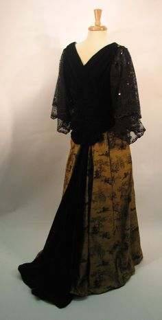 1898 dinner suit in a Chinese design damask with silk velvet bodice back and train insert. Machine lace double sleeves with sequin trim. This costume was custom made for a client by As They Sew In France studios.