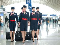 Christian Lacroix designed China Eastern Airline's 'simple, beautiful and dignified' uniform. Air France, Christian Lacroix, Air Hostess Uniform, China Eastern Airlines, New Airline, Pilot Uniform, Airline Uniforms, Staff Uniforms, Navy Shirt Dress