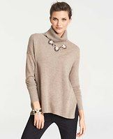 Collectible Cashmere Side Slit Turtleneck Sweater - It takes us a year to get our cashmere just right. Incredible softness, chic curated colors, the perfect weight (not to mention irresistible swoon factor) make it the gift you can be proud to give…and get. Detailed with chic side slits, our ultra luxe cashmere imparts an incredible softness to this irresistibly relaxed yet refined turtleneck sweater. Turtleneck. Long sleeves. Side slits. Ribbed neckline, cuffs and hem.