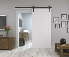 Nowadays the existence of sliding doors is increasingly popular among designers and homeowners. This is because sliding doors not only offer better utiliza Sliding Door Design, Sliding Barn Door Hardware, Sliding Doors, Farmhouse Interior, Interior Barn Doors, Barn Door Designs, Diy Barn Door, Wood Doors, Interior Design Living Room