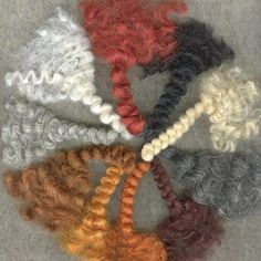Curly Braided Wool Roving in 10 colors including greys. Unbraid for wavy curls and beards. A Child's Dream http://www.achildsdream.com/curly-braided-wool-roving/