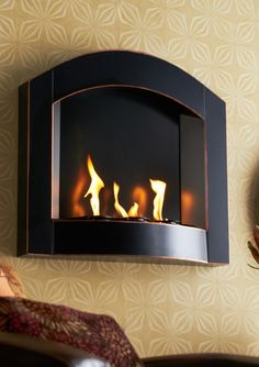 So you can't go full-on Yule Log on this cold day, but you can fake it with a not-too-badly priced electric fireplace VIA ideel